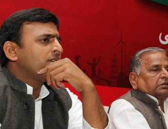 LUCKNOW, INDIA - MARCH 9: Samajwadi Party chief Mulayam Singh Yadav (R) sits with his son Akhilesh Yadav at press conference at the party office on March 9, 2012 in Lucknow, India. According to some media reports Yadav is likely to be selected the new Chief Minister of Uttar Pradesh in SP legislature party Meeting to be held on March 10, 2012. (Photo by Arvind Yadav/ Hindustan Times via Getty Images)