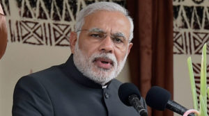Fiji: Prime Minister Narendra Modi speaks during a traditional welcome ceremony in Fiji on Wednesday. PTI Photo by Kamal Singh (PTI11_19_2014_000033A)