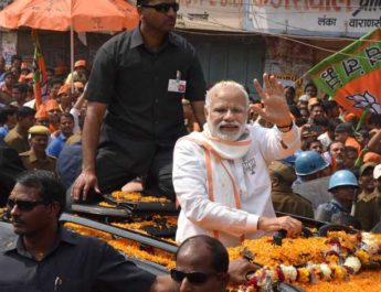 Varanasi: Prime Minister Narendra Modi at a road show in Varanasi on Saturday. PTI Photo (PTI3_4_2017_000048B)